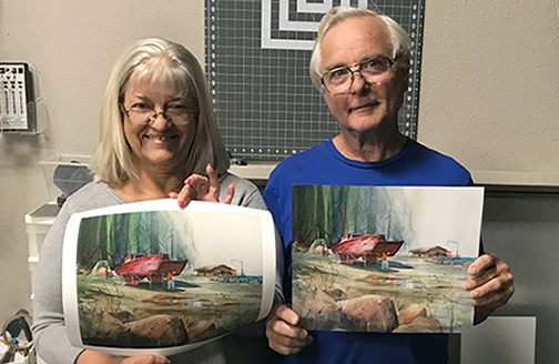 two customers comparing their original art with our reproduction