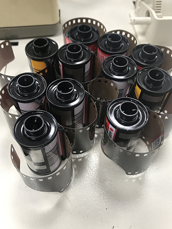 rolls of film being prepped for developing